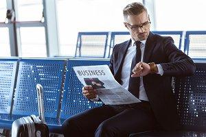 adult businessman sitting with newsp
