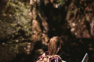 Female hiker with map looking away