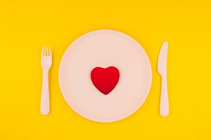 Red heart on serving table. Romantic