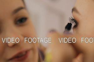 A professional makeup artist applies