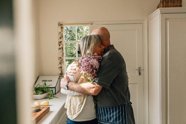 People Stock Photos: Jacob Lund - Senior couple embracing standing