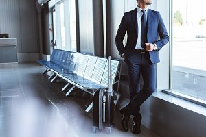 businessman standing at departure lo
