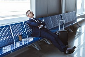 exhausted businessman in glasses sit