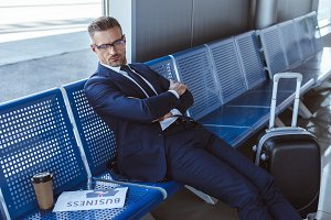 tired businessman in glasses sitting