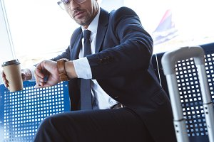businessman in glasses sitting near