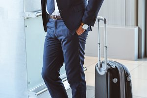 handsome businessman with suitcase s