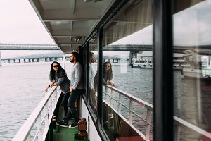 Guy and girl on board a cruise boat