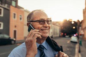 Senior businessman on city street