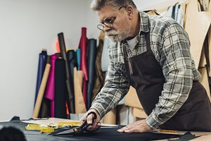 focused handbag craftsman in apron a