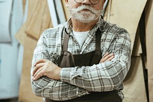 cheerful middle aged craftsman in ap