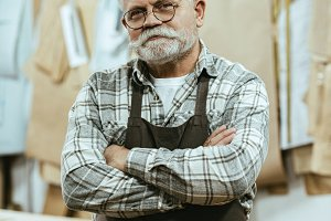 smiling mature craftsman in apron an