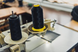 selective focus of black sewing stri