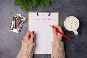 Woman hands ready to write new year