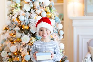 Happy smiling Boy in santa hat with