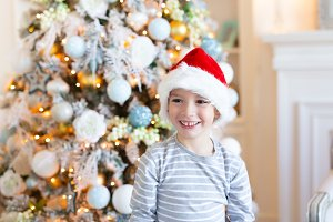 Happy smiling Boy in santa hat