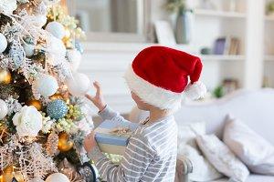 Christmas Eve. Boy in santa hat