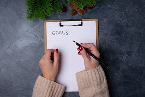 Woman hands ready to write goals on