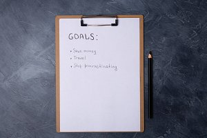 Paper with list of goals and black
