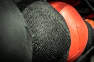 Medicine Balls On A Rack In A Gym