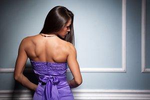 Woman in purple silk waving dress