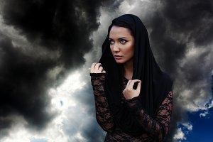 Young beautiful woman with the black