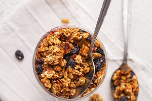 Baked granola with raisins in bowl