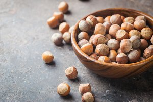 Natural hazelnut in a wooden bowl