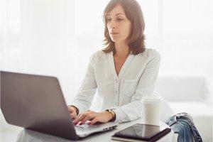 Freelancer using notebook, woman