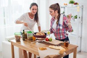 Women baking at home fresh bread in