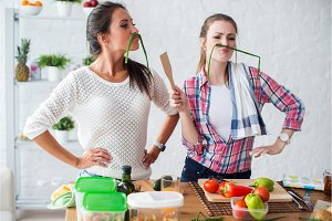 Women preparing healthy food playing