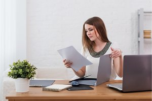 businesswoman with laptop and diary
