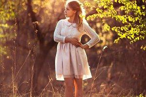 Beautiful girl standing in a field o