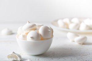Meringues dessert on white wooden