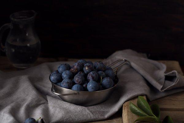 Food Stock Photos - Blue blackthorn or sloe berries on