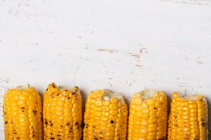 Grilled corn cobs on the rustic