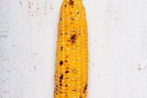 Single grilled corn cobs on the