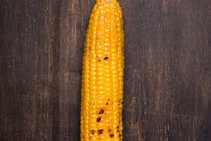 One Grilled corn cob on the brown