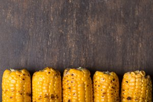 Grilled corn cobs on the brown