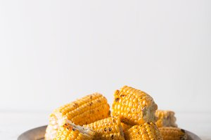 Grilled corn cobs on the white