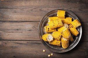 Grilled corn cobs on the metallic