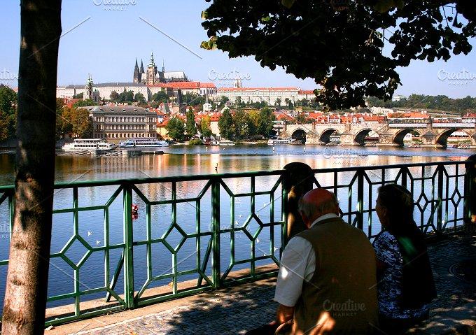 Couple near Valtva river. Prague - Architecture