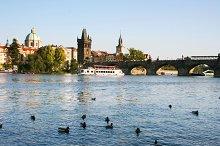 CharlesBridge view with boats.Prague