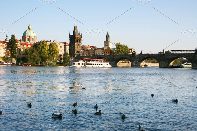 CharlesBridge view with boats.Prague - Architecture