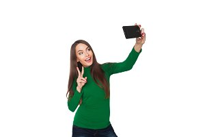 Pretty girl photographing selfie