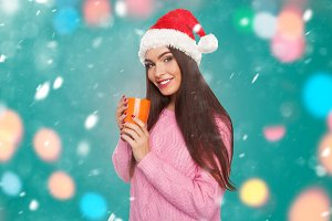 Girl holding cup with hot drink
