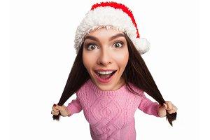 Model in christmas hat pulling hair
