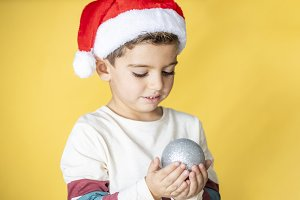 Cute kid with Santa´s hat