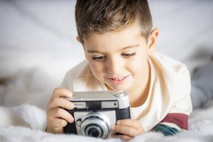 Beautiful boy with a photographing