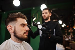 Handsome bearded man at the barbersh
