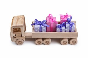 Wooden toy car with gifts in back